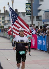 Jimmy Rohrig of Rockland County, NY carries an American flag throughout the 2019 Novo Nordisk New Jersey Half Marathon which started at Monmouth Park in Oceanport and ended at Ocean Promenade in Long Branch.