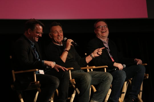 Thom Zimny (L-R), Bruce Springsteen and Chris Phillips on the stage of the Paramount Theatre in Asbury Park as part of the APMFF.