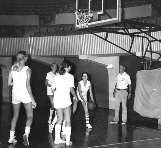 Stanley Whisenhunt coaches the North All-Stars in practice before the 1973 Texas High School Girls' Coaches Association game at the Brownwood Coliseum.