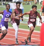 Brownwood's Khyren Deal, center, hands the baton to teammate Royshad Henderson during the boys 800-meter relay. They teamed up with Braden Jetton and A.J. McCarty to win the event in 1:27.10 at the Region I-4A track and field meet Saturday, April 27, 2019, at Lowrey Field in Lubbock.
