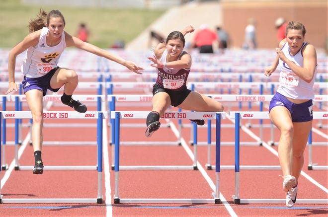 Brownwood's Trinity Buitron, center, clears the last hurdle in the 100-meter hurdles, while Canyon's Mackenzie Grimes, right, and Godley's Taylor McFarland eye the finish line. Grimes won the race in 15.32, and McFarland was second (15.43). Buitron was fourth (15.87) at the Region I-4A track and field meet Saturday, April 27, 2019, at Lowrey Field in Lubbock.