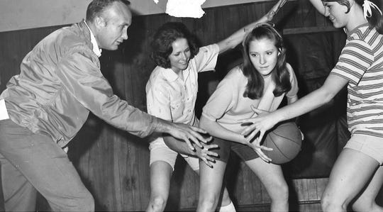 Stanley Whisenhunt teaches his players that defense is paramount in the six-player basketball game. The players are Judy Holloway, Brenda Brzozowski and Sandra Jackson. The trio were on the 1970 Wylie High team that won the Class 1A state championship.
