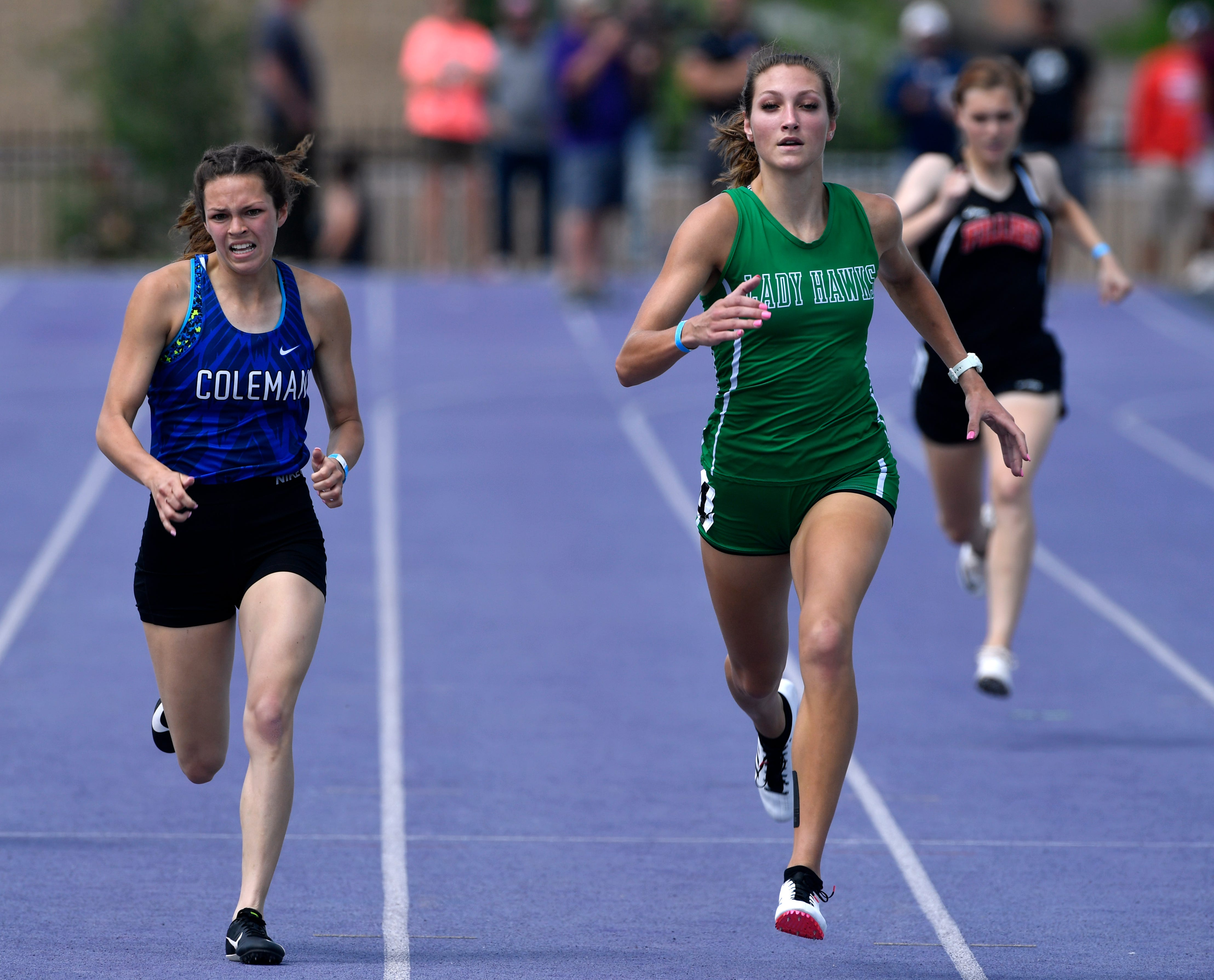 Shiean Walters of Coleman tries to close the distance between her Wall's Jayden Fiebiger in the 400 meter dash during Saturday's Region 1-3A track meet at Abilene Christian University April 27, 2019.