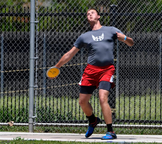 Konner Wood of Holliday throws the discus during Saturday's the Region 1-3A track meet at Abilene Christian University April 27, 2019.