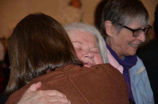 The Rev. Charlotte A. Ellison gets a hug during the final service for the First Presbyterian Church of Albion.