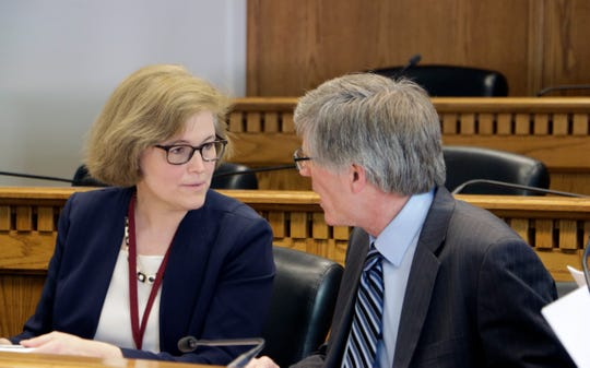 Sen. Christine Rolfes and Rep. Timm Ormsby talk before the start of a meeting to sign a conference committee report on a state budget plan, on Saturday, April 27, 2019, in Olympia, Wash. State lawmakers are facing a midnight Sunday deadline to avoid going into overtime to pass a new, two-year state budget. (AP Photo/Rachel La Corte)