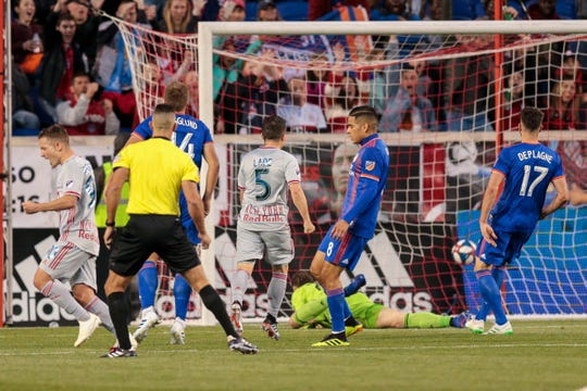 New York Red Bulls defender Connor Lade (5) reacts after scoring a goal past as midfielder Marc Rzatkowski (90) reacts FC Cincinnati goalkeeper Przemyslaw Tyton (22) during the first half at Red Bull Arena.