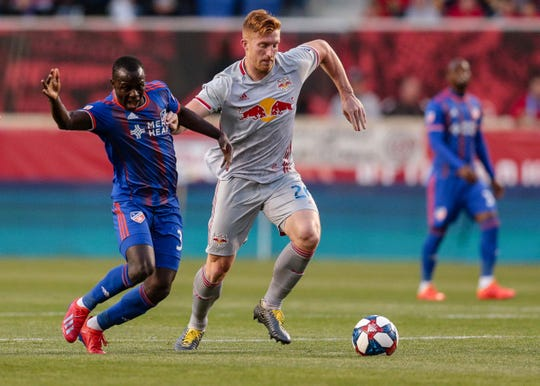 New York Red Bulls defender Tim Parker (26) battles for the ball against FC Cincinnati defender Forrest Lasso (3) during the first half at Red Bull Arena.