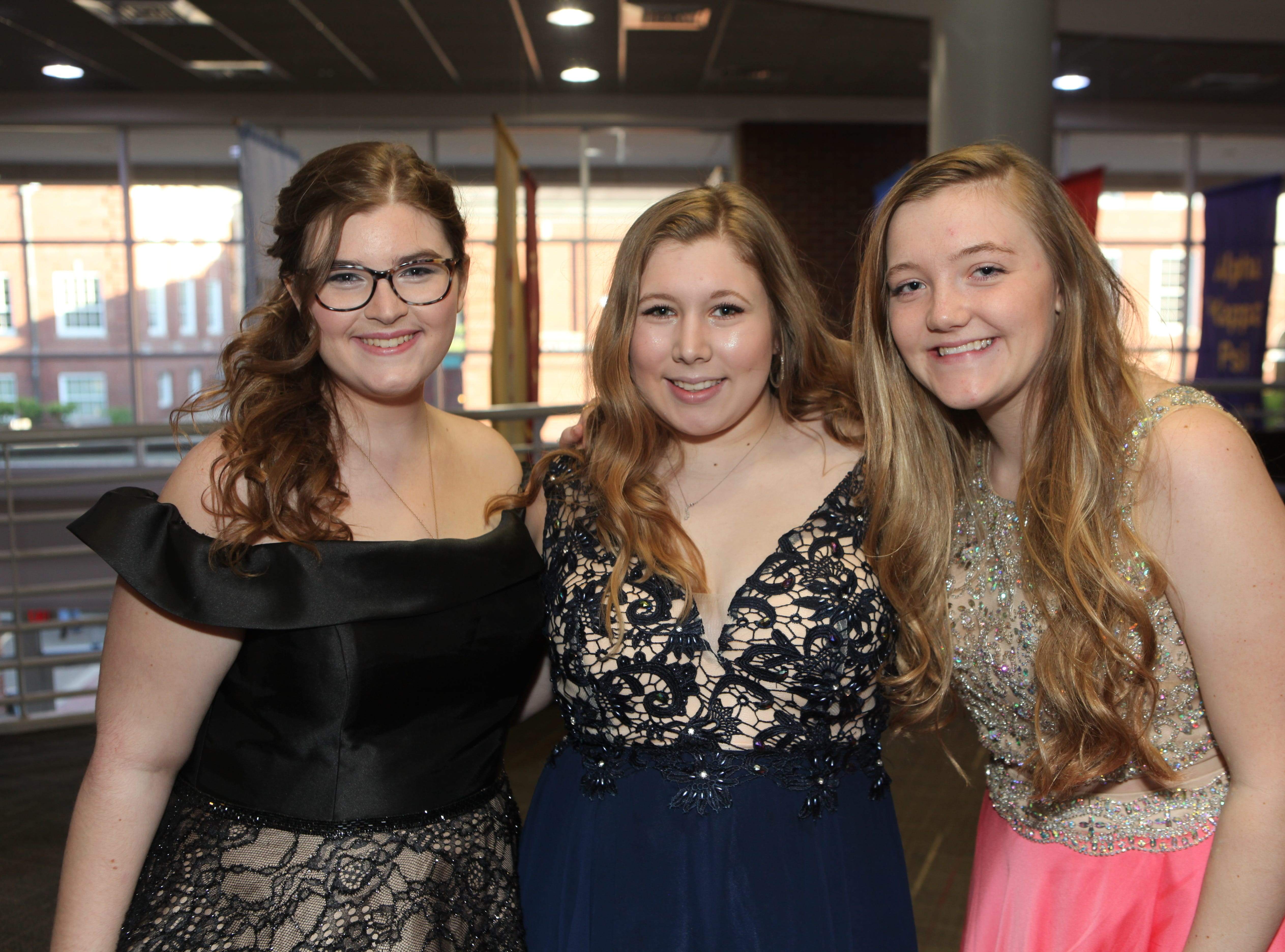 Catherine Sheffield, Emma Williams and Kaitlyn Clayman at the Middle College 2019 prom at the APSU Ballroom on Friday, April 26, 2019.