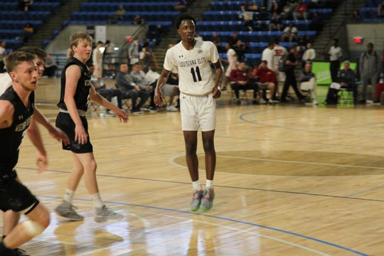 Louisiana Elite guard LaDamien Bradford plays during the Under Armour Association Session II in Kansas City.