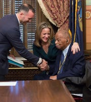 Judge Damon J. Keith of the U.S. Court of Appeals for the Sixth Circuit with Michigan Secretary of State Jocelyn Benson and her husband, Ryan Friedrichs, on Jan. 1, 2019, the day Benson was sworn in as secretary of state. Keith participated in the ceremony by swearing in Benson.