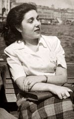 Margherita Feldman was 18 when this photograph of her sitting on a bench in Italy after World War II.