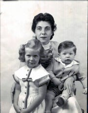 Margherita Feldman holds her children, Eva and George, on her lap for this passport photo.