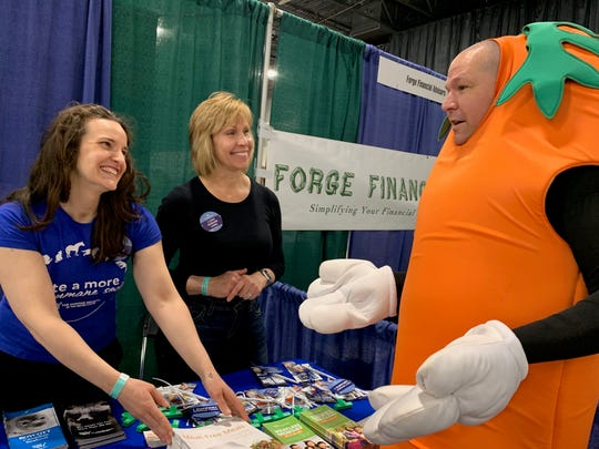 From left, Molly Tamulevich, Michigan director of the Humane Society of the U.S.; Sheila Kellogg, a Humane Society of the U.S. volunteer; and Daniel Earle, a VegFest 2019 volunteer, at Suburban Collection Showplace on Sunday, April, 28, 2019.