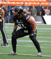 Jahlani Tavai of Hawaii fits the mold of a larger linebacker in which the Lions apparently covet.