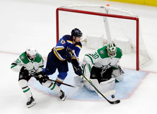 The St. Louis Blues' Jaden Schwartz  scores past Dallas Stars goaltender Ben Bishop during the third period.