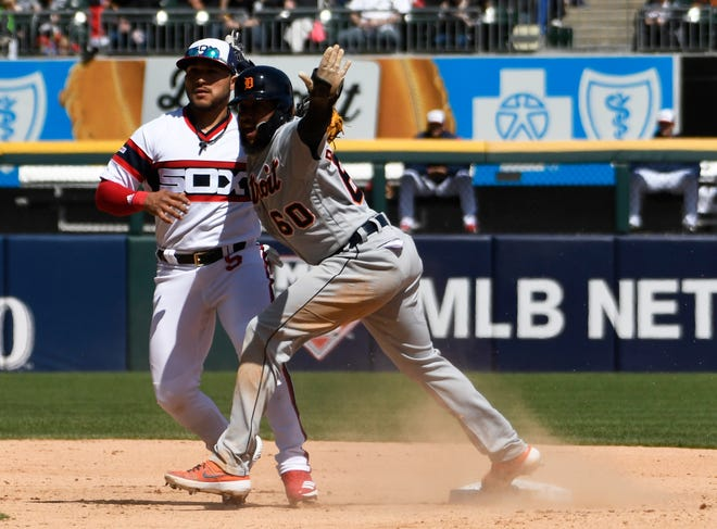 Detroit's Ronny Rodriguez (60) gestures after he was tagged out on a steal attempt at second base by Chicago's Yolmer Sanchez during the fifth inning on Sunday.