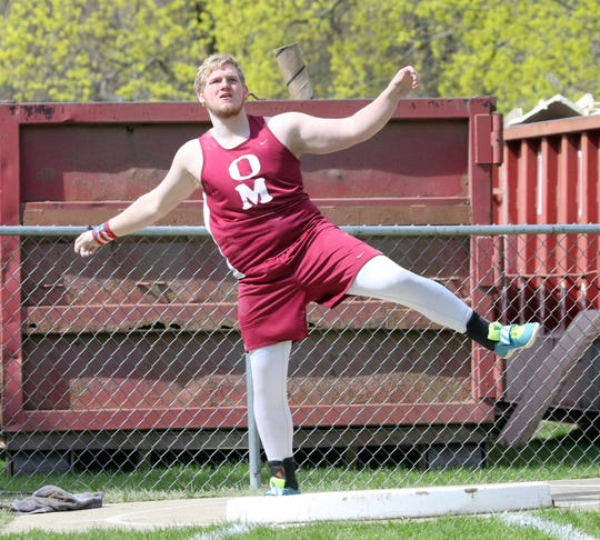 Zach Elliott of Odessa-Montour watches his throw in the shot put at the Waite-Molnar Invitational on April 27, 2019 at Elmira's Ernie Davis Academy.