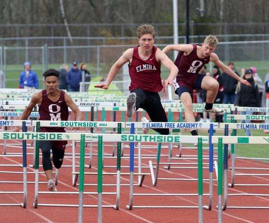 Cole Marks of Elmira runs to a win in the 110-meter hurdles at the Waite-Molnar Invitational on April 27, 2019 at Elmira's Ernie Davis Academy. At left is Odessa-Montour second-place finisher Preston Harris and at right is O-M's Paden Grover, who finished fourth.