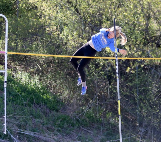 Gwen Gisler of Lansing clears the bar on her way to first place in the pole vault at the Waite-Molnar Invitational on April 27, 2019 at Elmira's Ernie Davis Academy.
