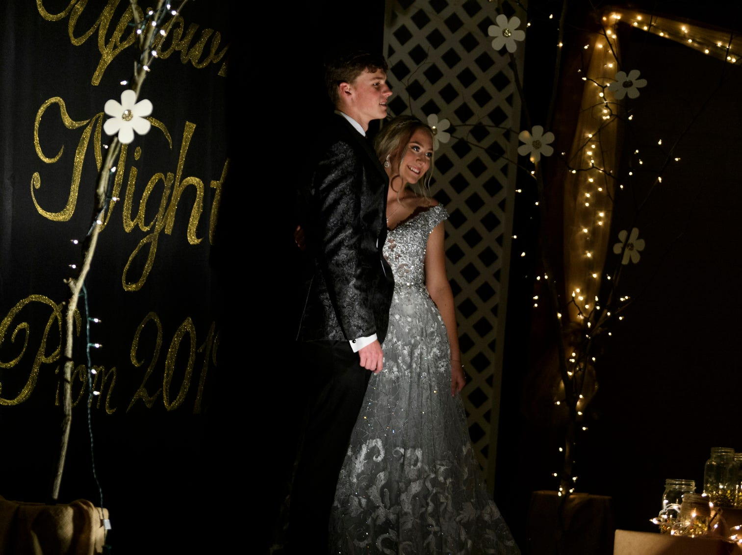 """Cooper Humphrey and Bailey Richie pose for a photo during Central High School's """"Uptown Night"""" themed prom held at the Vanderburgh 4-H Center auditorium in Evansville, Ind., Saturday, April 27, 2019."""