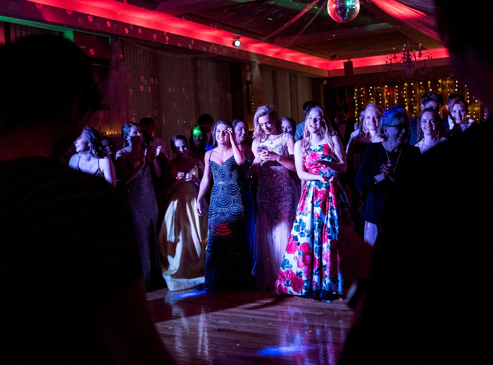 Evansville Day School students create a dance circle for someone to jump into during their prom held at the Hadi Shrine Banquet Hall in downtown Evansville, Ind., Saturday, April 27, 2019.