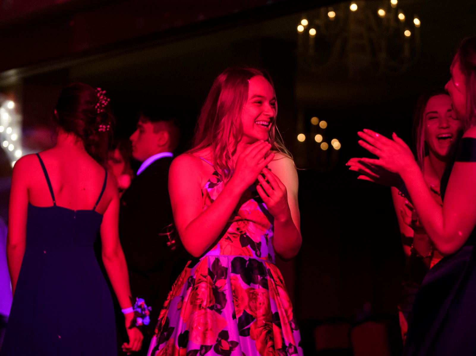 Lily Burke, center, laughs as she dances with friends CC Risewick, front right, and Kaitlin Zuzich, back right, during Evansville Day School's prom held at the Hadi Shrine Banquet Hall in downtown Evansville, Ind., Saturday, April 27, 2019.