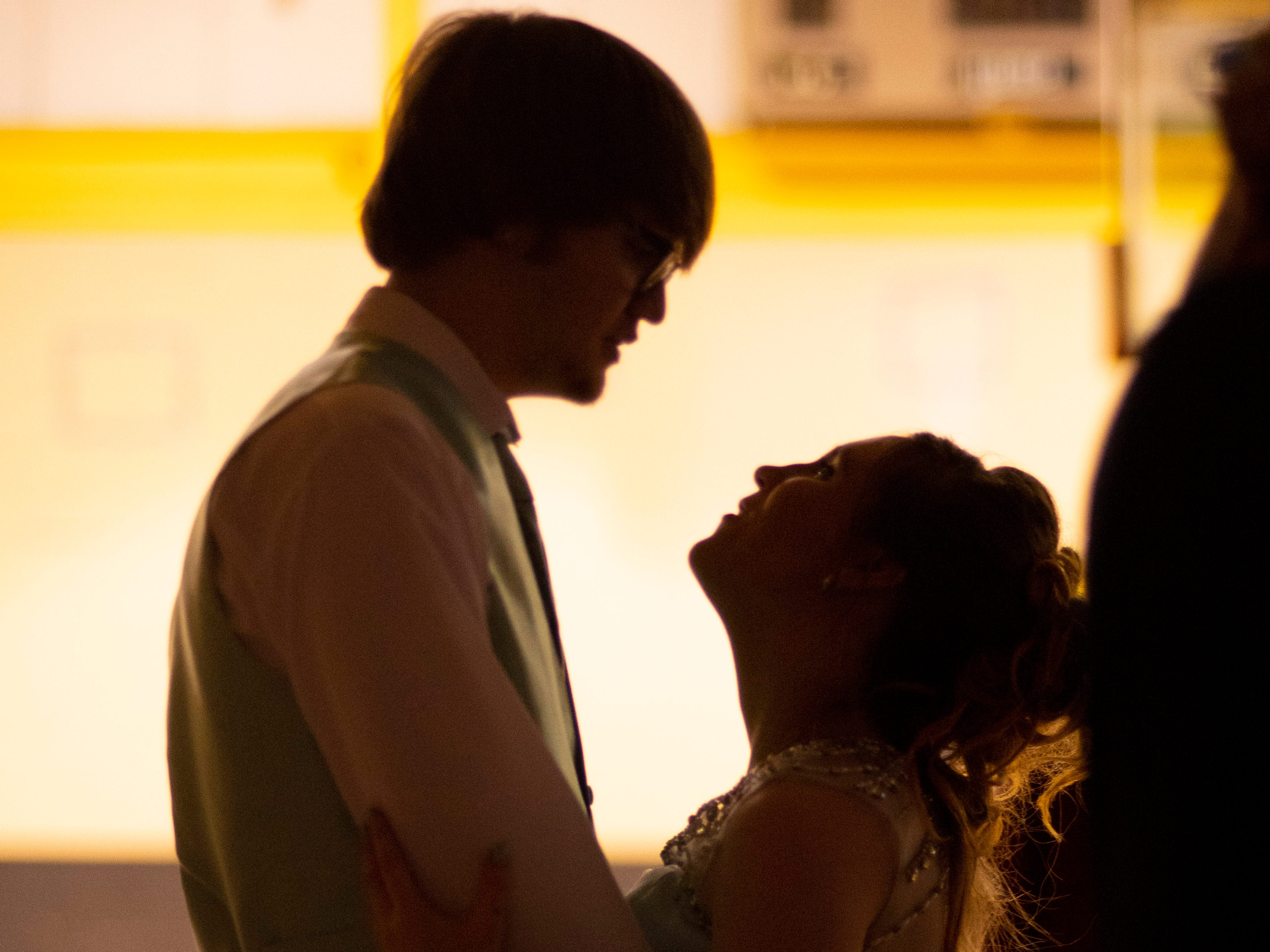 Caden King and Destiny Hebrard dance at the Harwood Career Prep prom Saturday night.