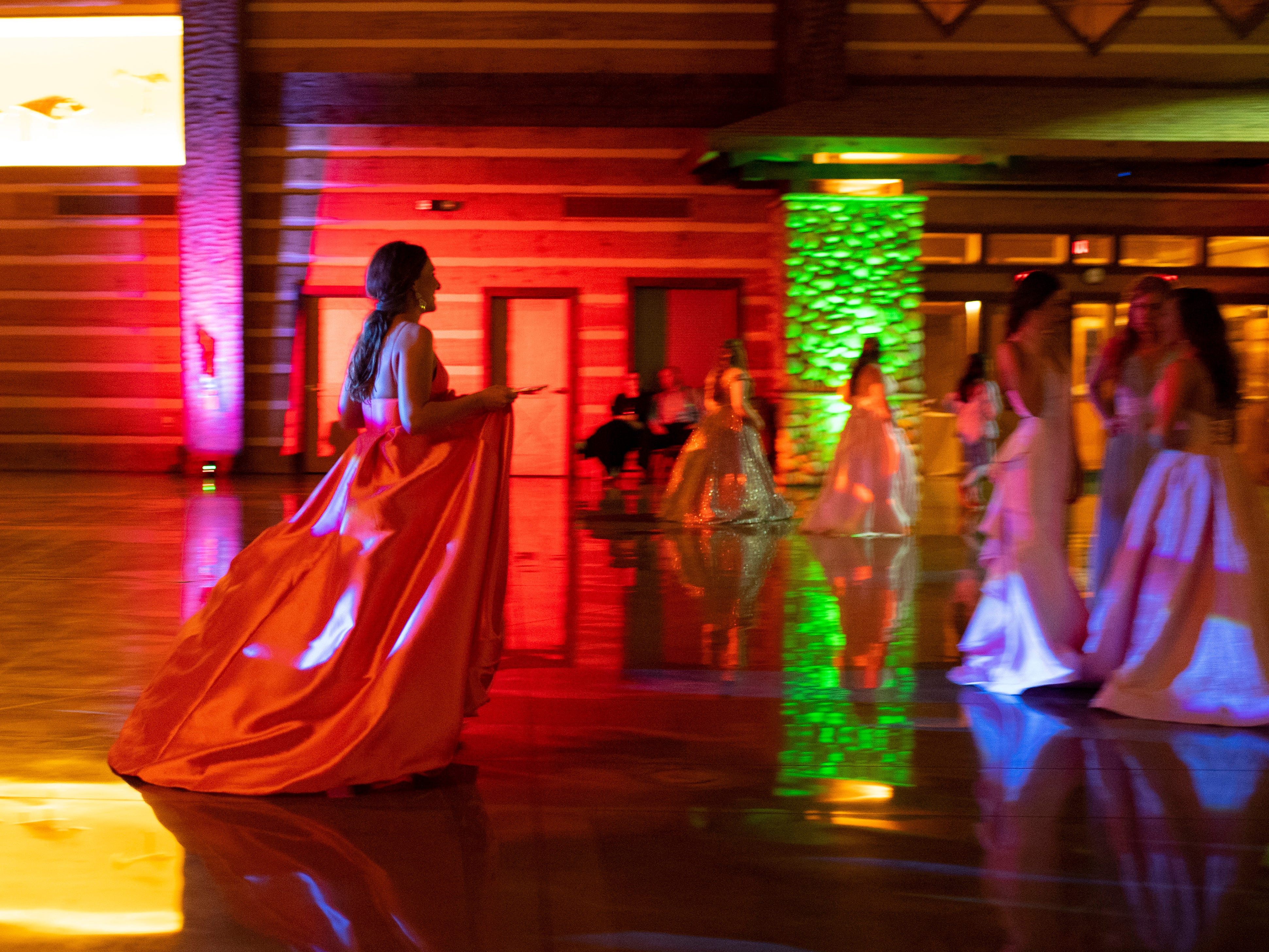 Students take a break from dancing at Mater Dei's prom at Burdette Park's Discovery Lodge Saturday night.
