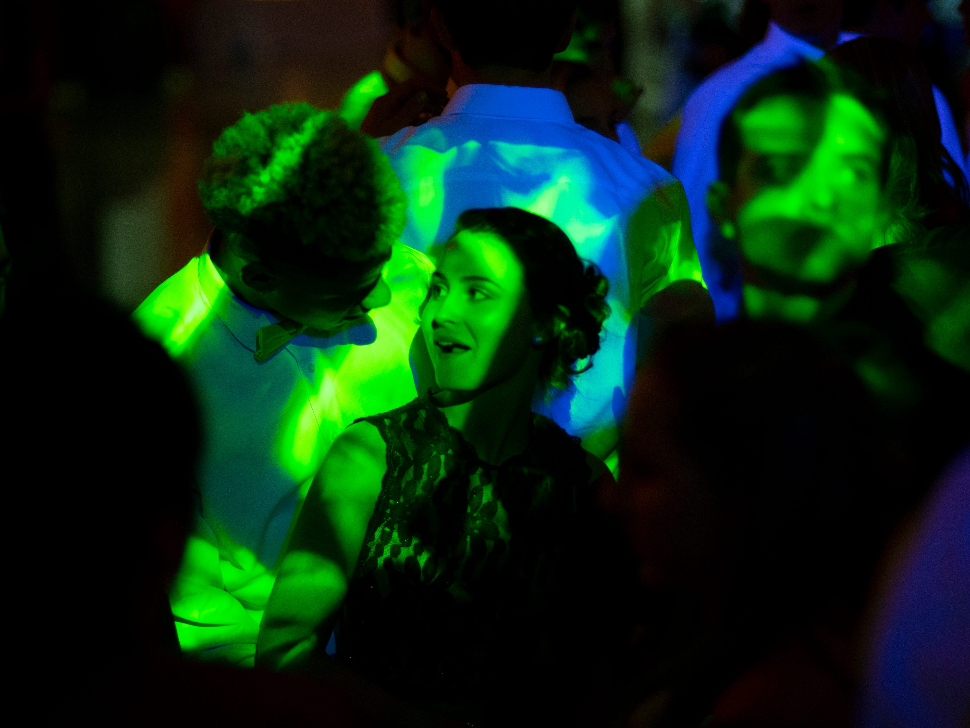 Students  Aubrey Singer, 16, and Cain Patton dance at Mater Dei's prom at Burdette Park's Discovery Lodge Saturday night.