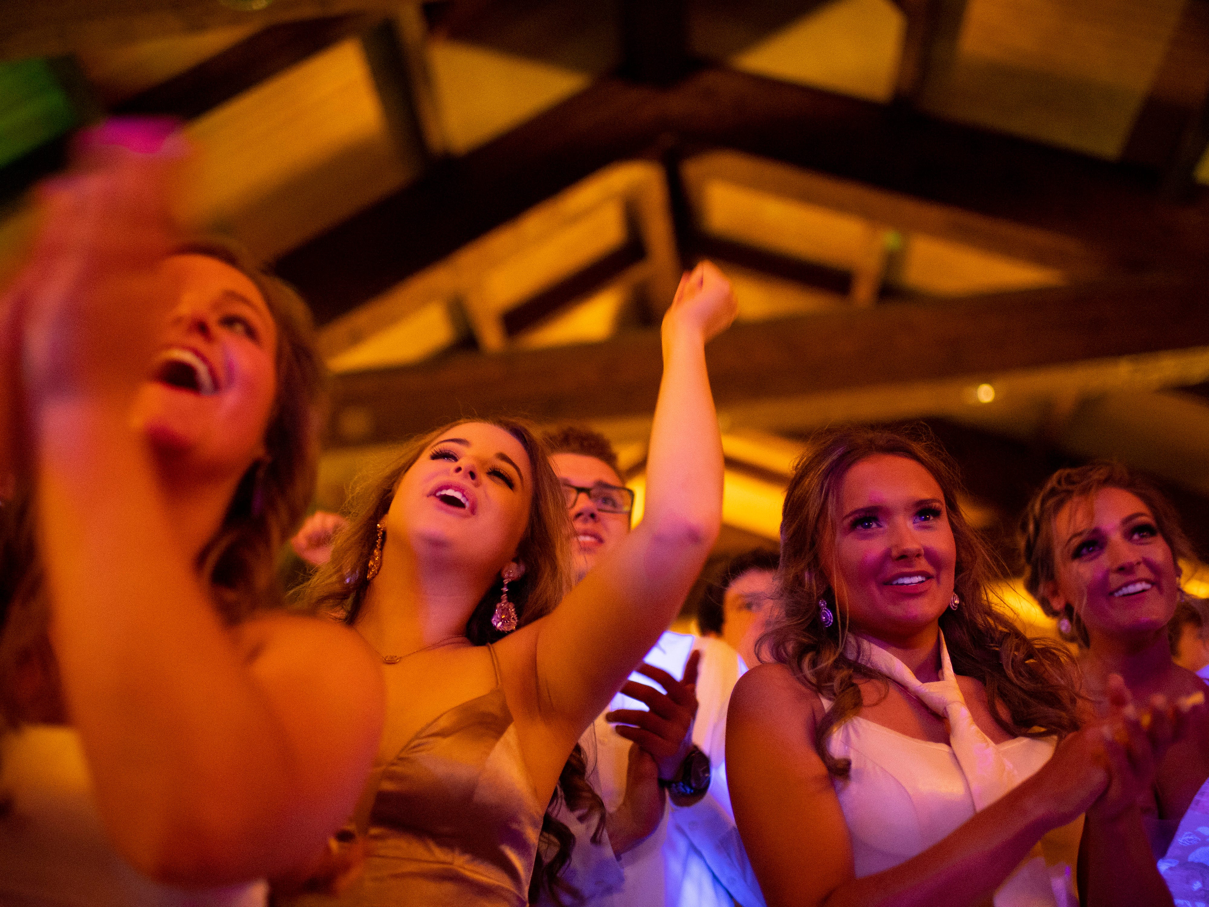 Students cheer the crowning of the prom king and queen at Mater Dei's prom at Burdette Park's Discovery Lodge Saturday night.
