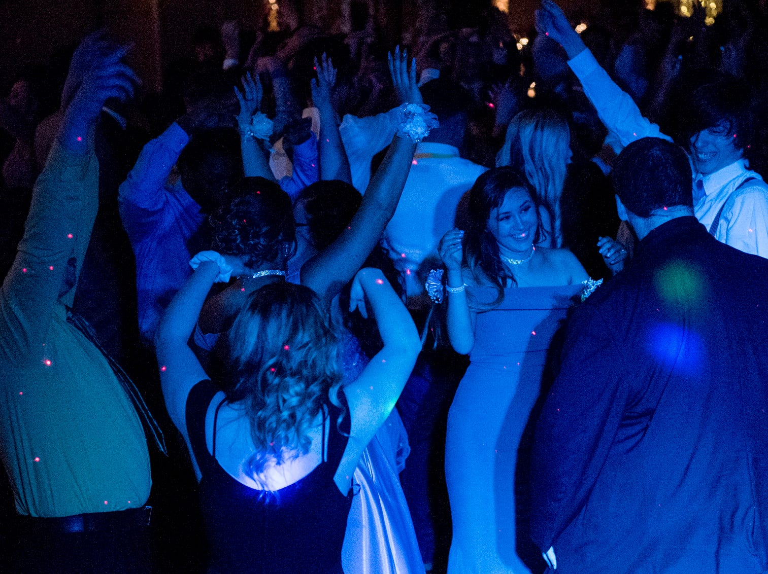 """Jasmine Richardson, center right, dances with her boyfriend Mason Bradley, far right, and their friends during Central High School's """"Uptown Night"""" themed prom held at the Vanderburgh 4-H Center auditorium in Evansville, Ind., Saturday, April 27, 2019."""