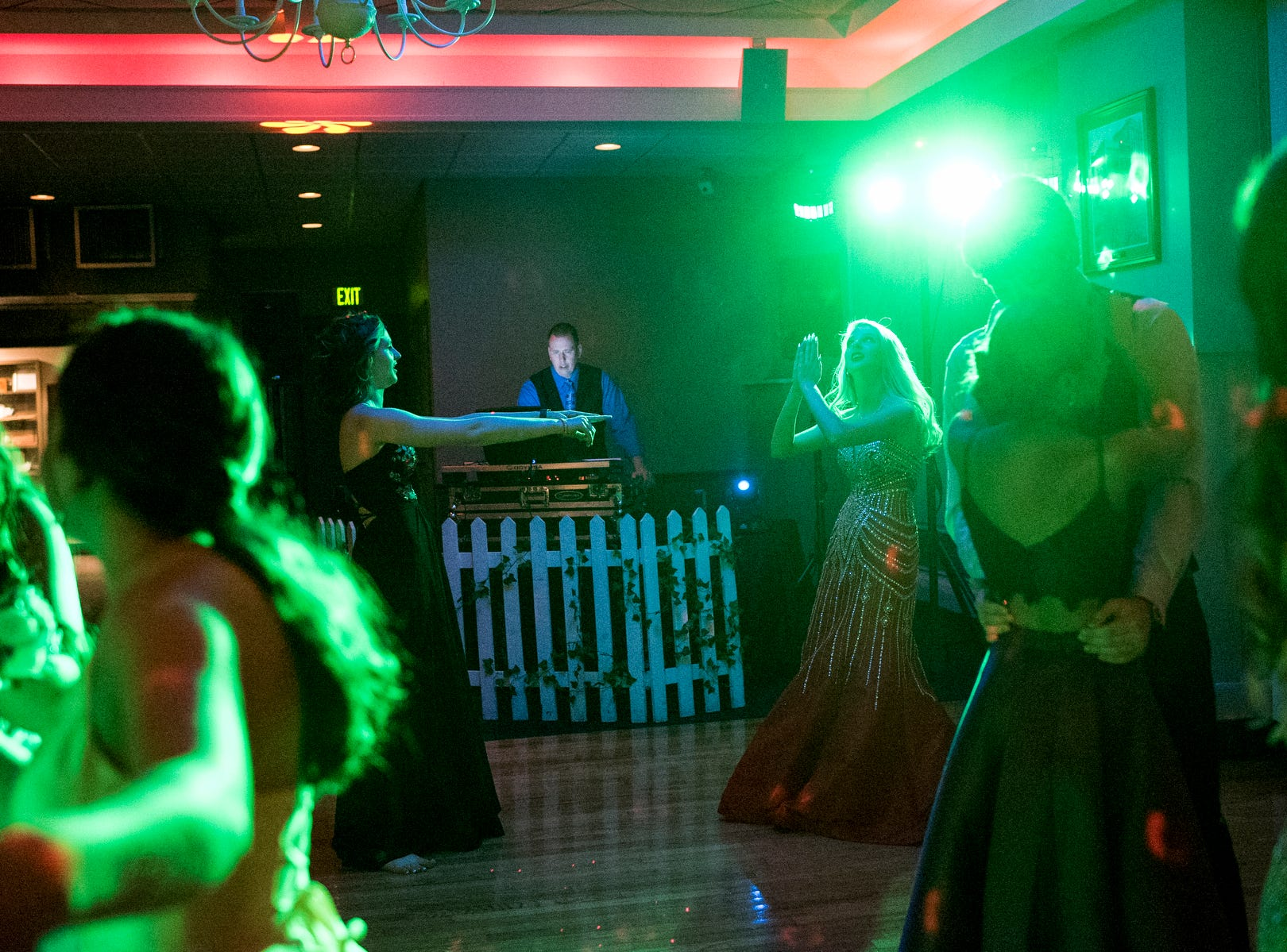 Lexi Albin, center left, and Josefine Trulsson, center right, dance together during Evansville Day School's prom held at the Hadi Shrine Banquet Hall in downtown Evansville, Ind., Saturday, April 27, 2019.