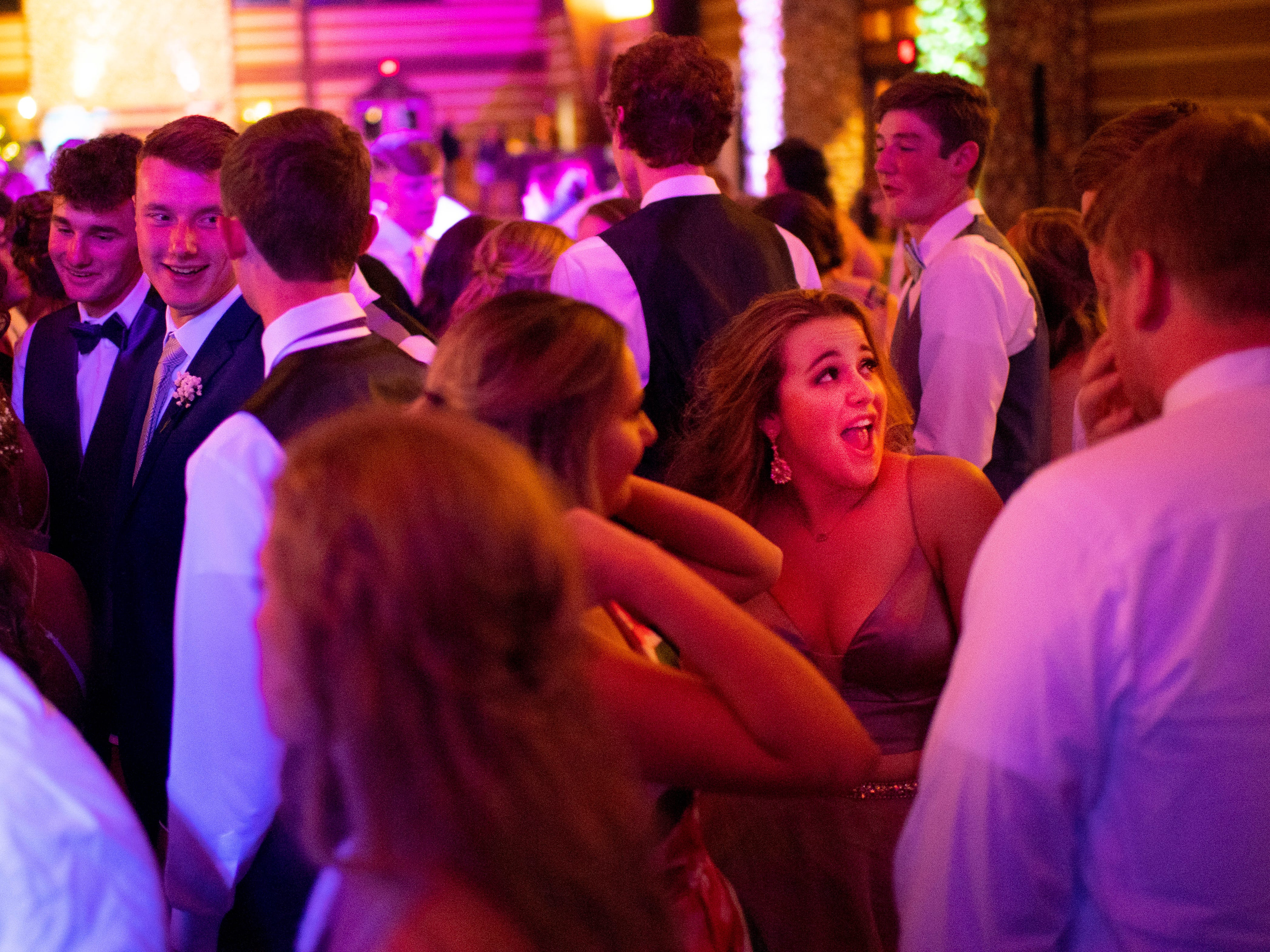 Students gather to dance in front of the stage at Mater Dei's prom at Burdette Park's Discovery Lodge Saturday night.