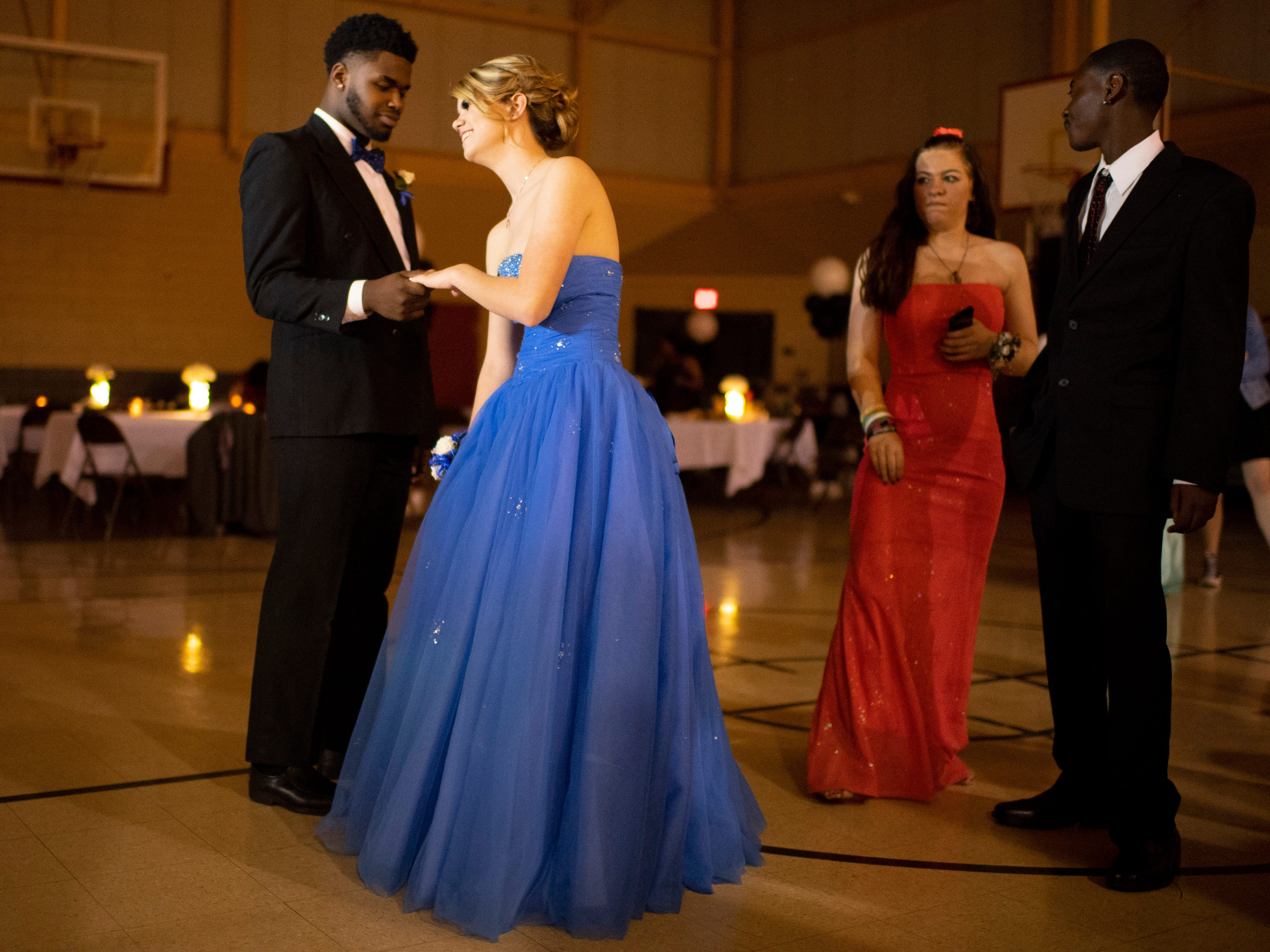 Martuis Fields, 17, left, and Alisha Smith, 17, dance at the Harwood Career Prep prom Saturday night.