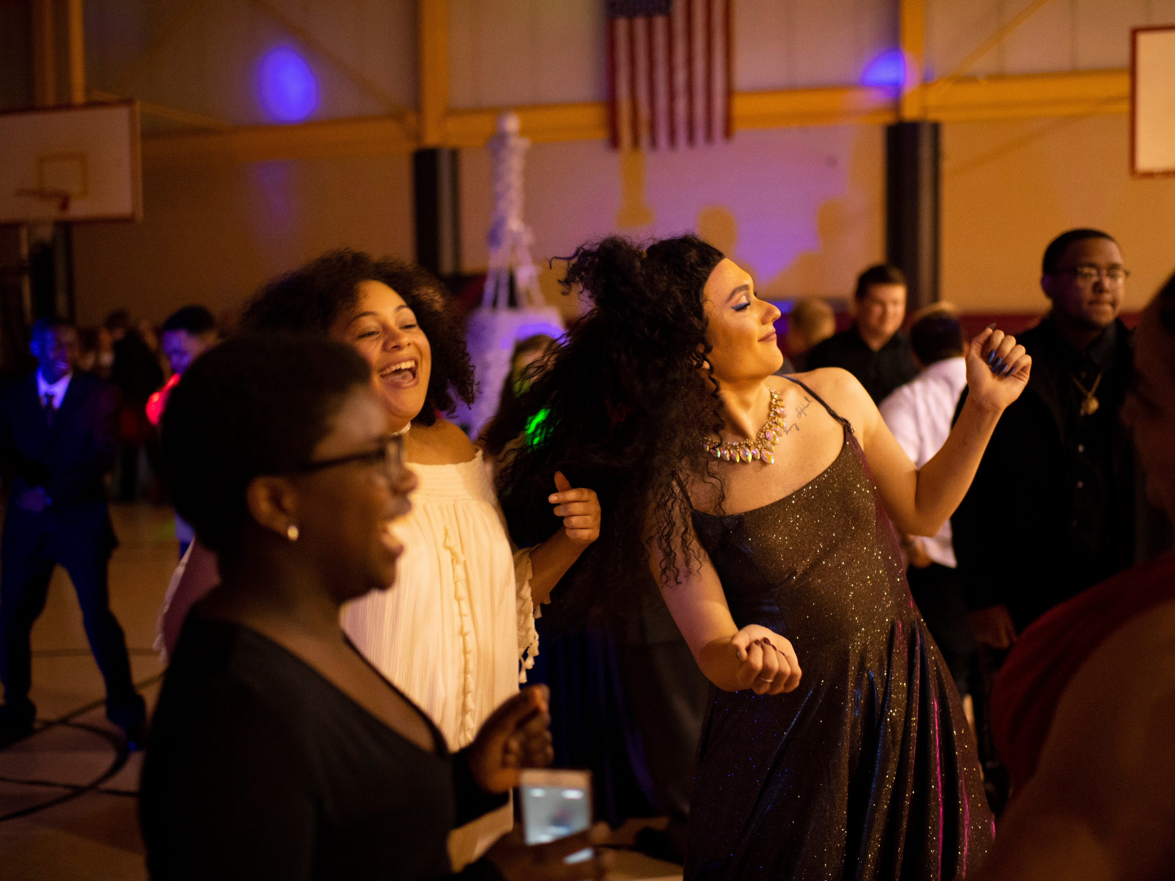 Students dance during A Night in Paris at the Harwood Career Prep prom Saturday night.