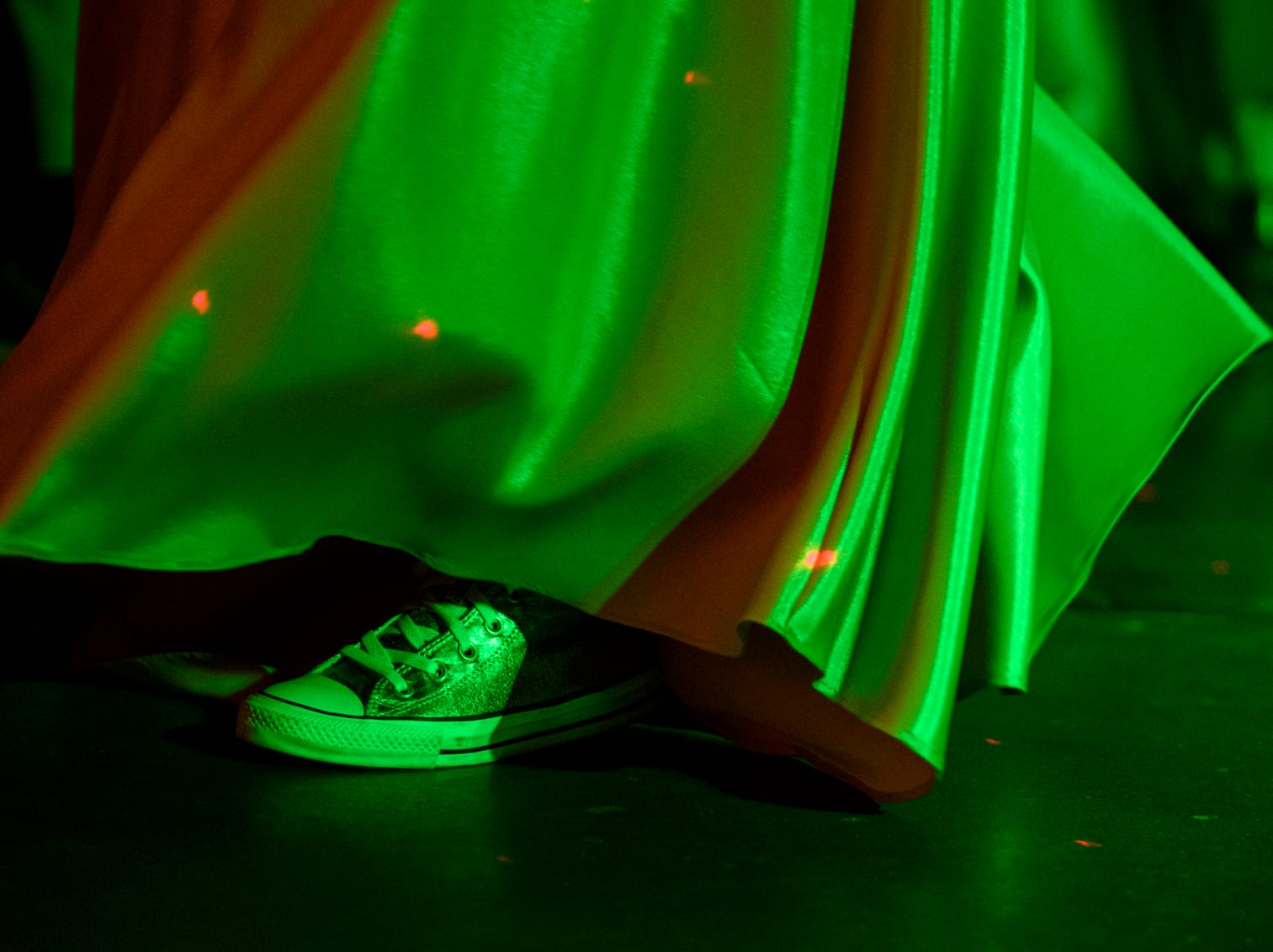 Sami Sulawske shows off her Converse Chuck Taylor shoes as she dances the night away with friends during Central High School's Uptown Night themed prom held at the Vanderburgh 4-H Center auditorium in Evansville, Ind., Saturday, April 27, 2019.