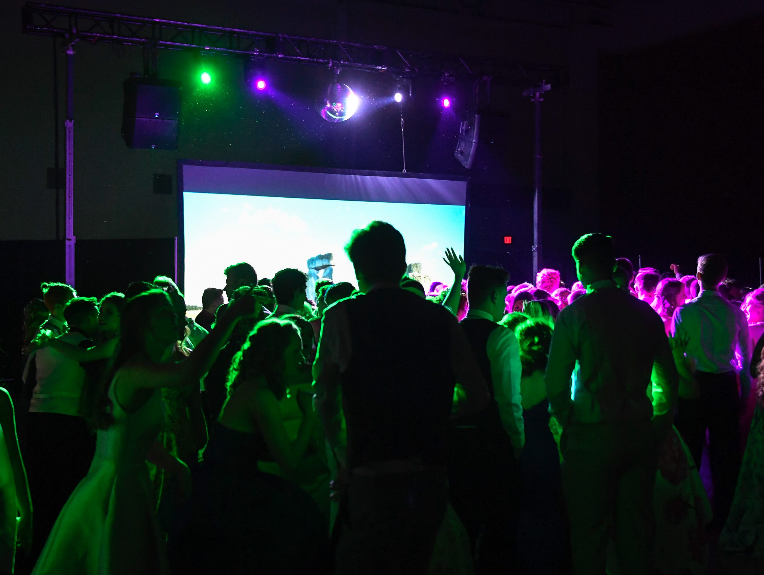 Couples converge on the dance floor at the Castle High School prom, held at the Old National Events Center Plaza Saturday, April 27, 2019.