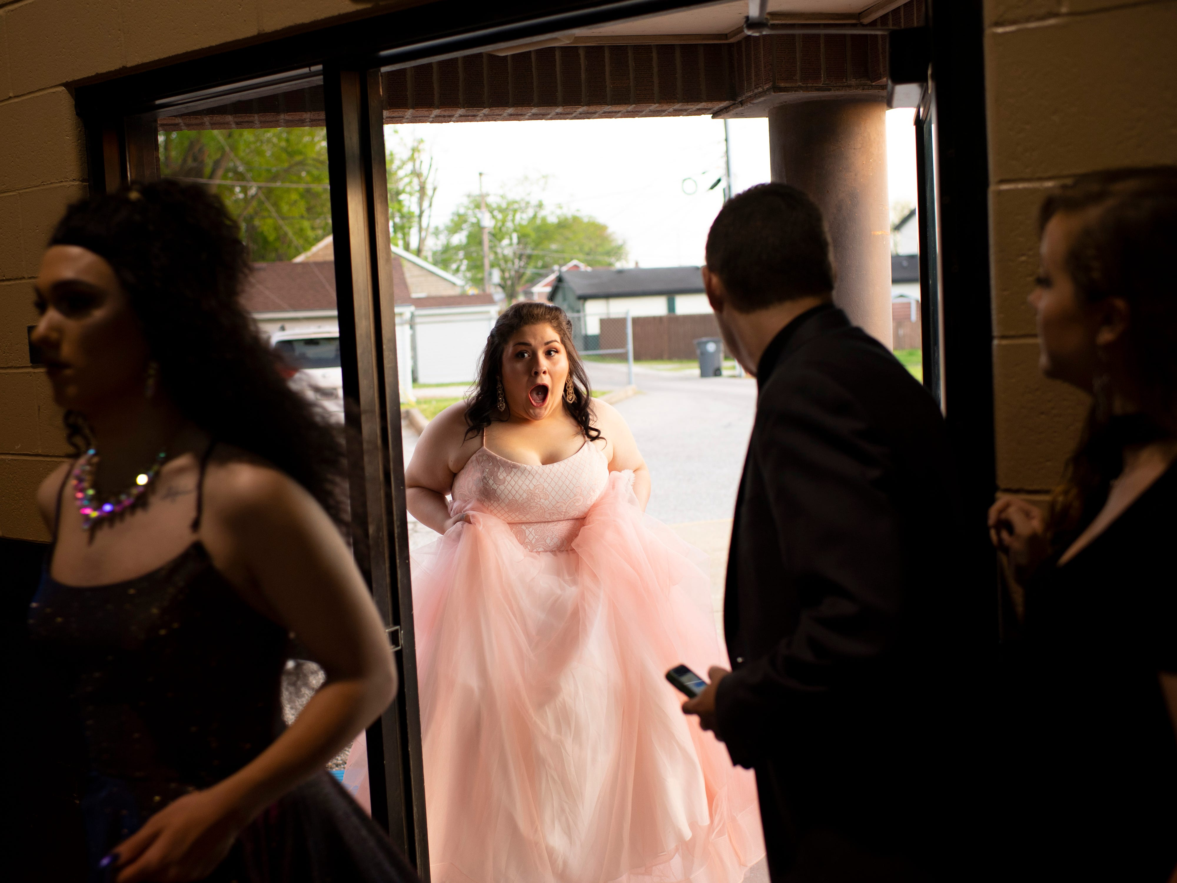 Jada Grimm enters the Harwood Career Prep prom ready to dance Saturday evening.