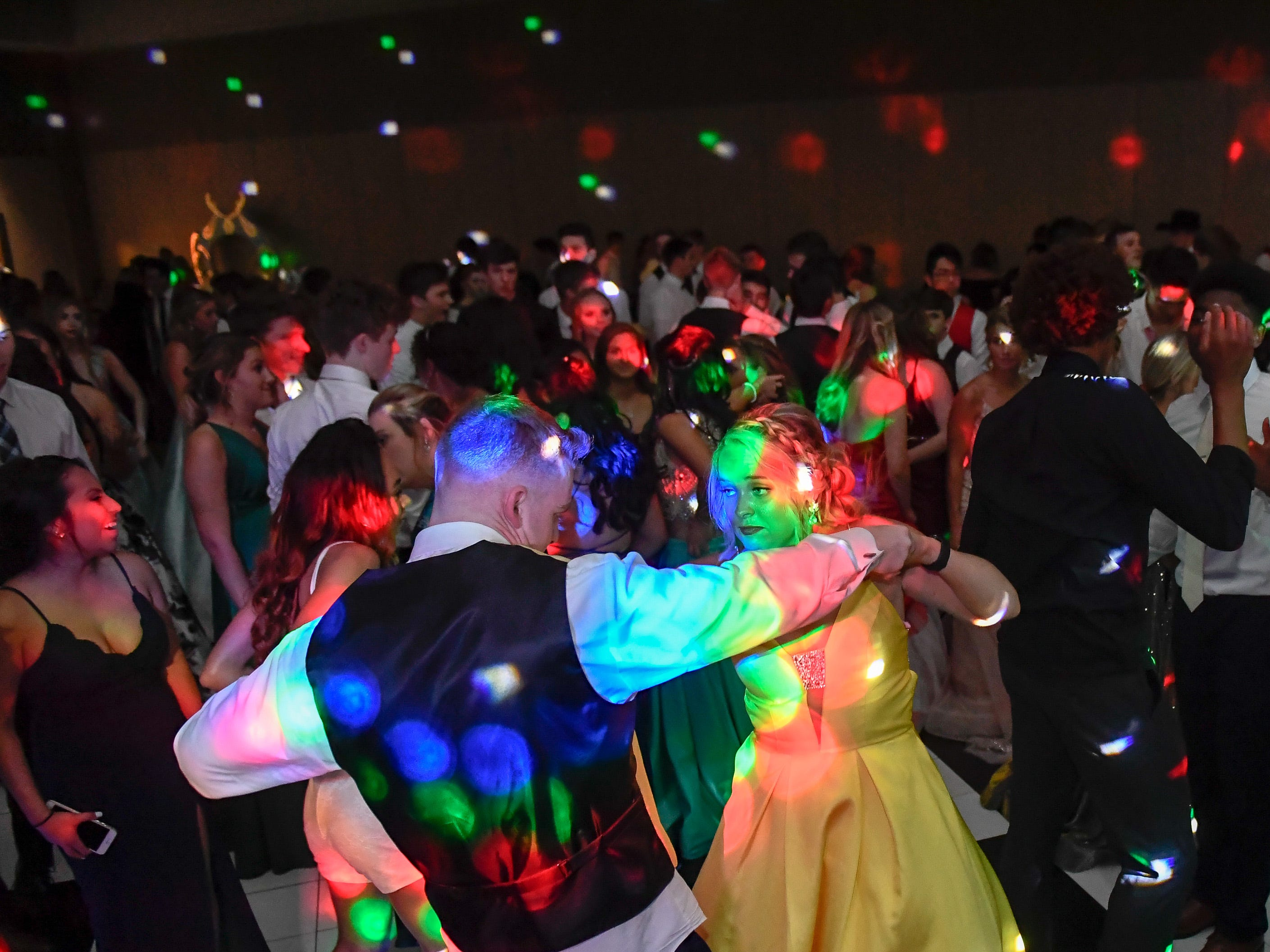 Katelynn Davis and Max Green on the dance floor at the Memorial High School prom, held at the Old National Events Center Plaza Saturday, April 27, 2019.