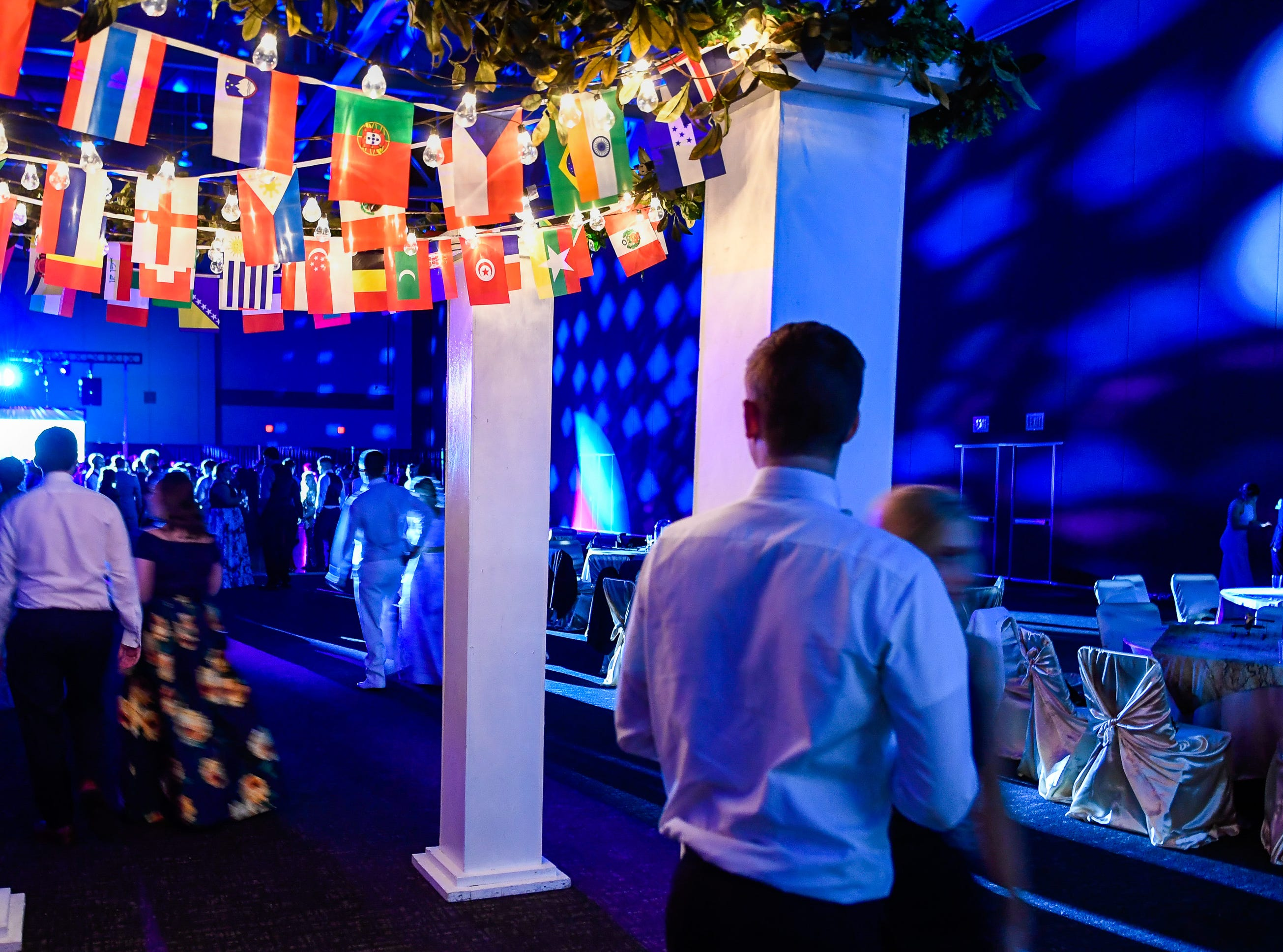 Couples enter the Castle High School prom, held at the Old National Events Center Plaza Saturday, April 27, 2019.
