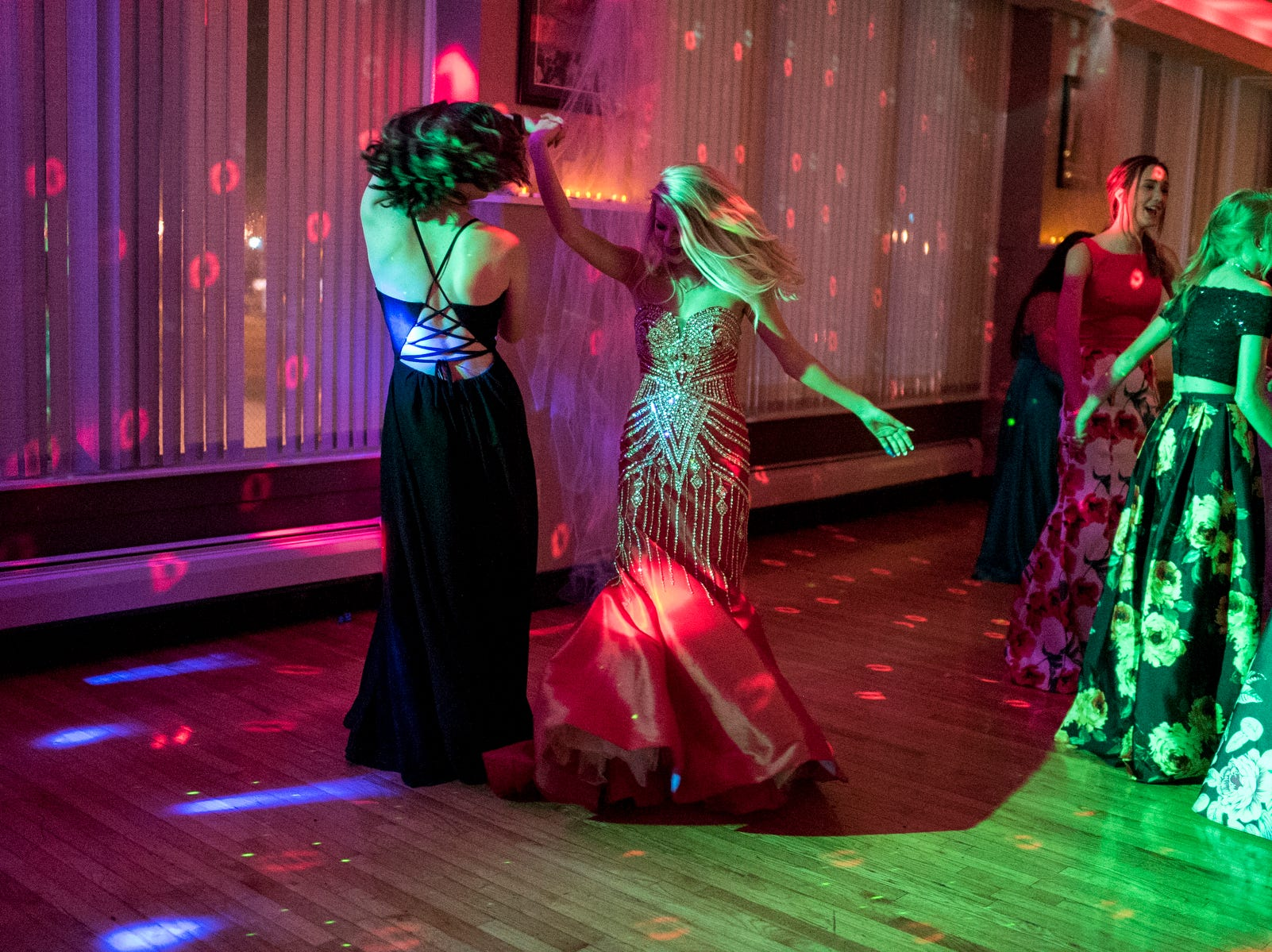 Lexi Albin, left, spins Josefine Trulsson, right, around on the dance floor during Evansville Day School's prom held at the Hadi Shrine Banquet Hall in downtown Evansville, Ind., Saturday, April 27, 2019.