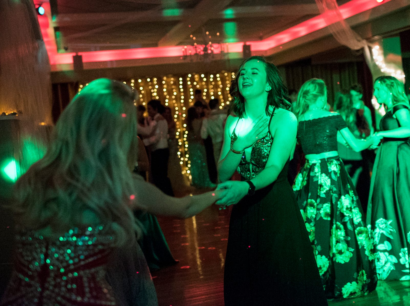 Josefine Trulsson, left, and Lexi Albin, right, dance together during Evansville Day School's prom held at the Hadi Shrine Banquet Hall in downtown Evansville, Ind., Saturday, April 27, 2019.