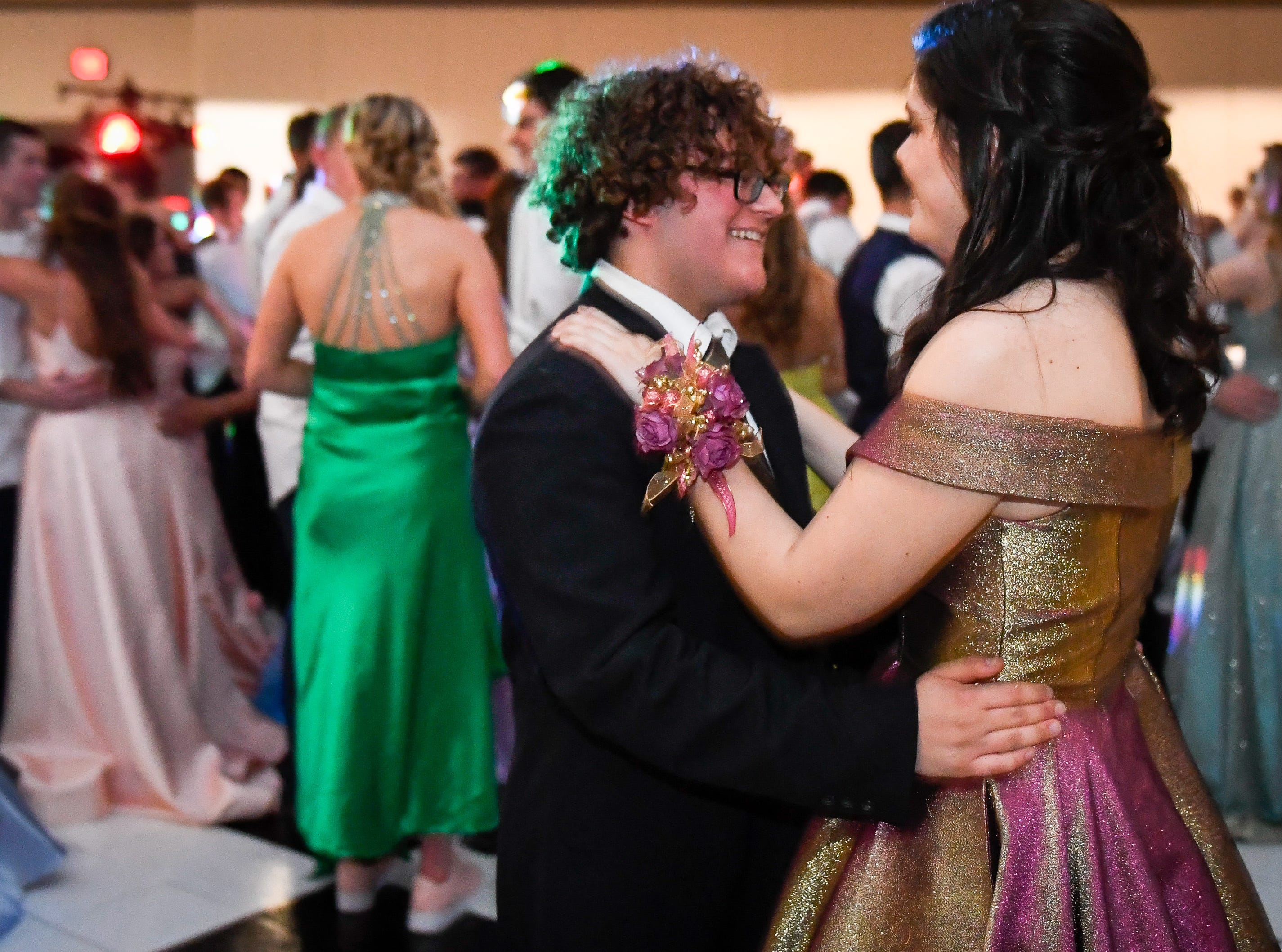 Jordan Nouri and Abby Nunn dancing at the Memorial High School prom, held at the Old National Events Center Plaza Saturday, April 27, 2019.