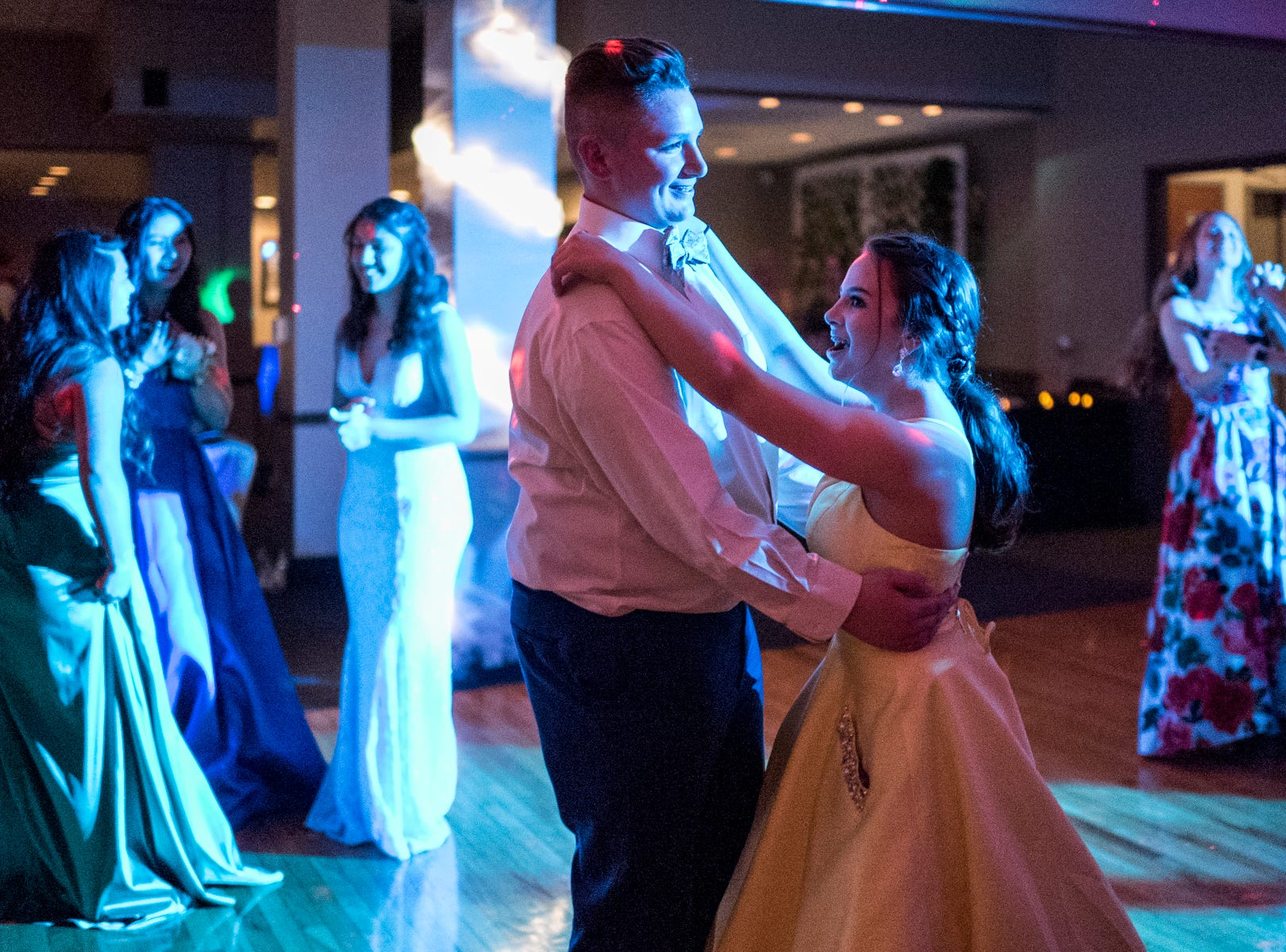 Evansville Day School students slow dance during their prom held at the Hadi Shrine Banquet Hall in downtown Evansville, Ind., Saturday, April 27, 2019.