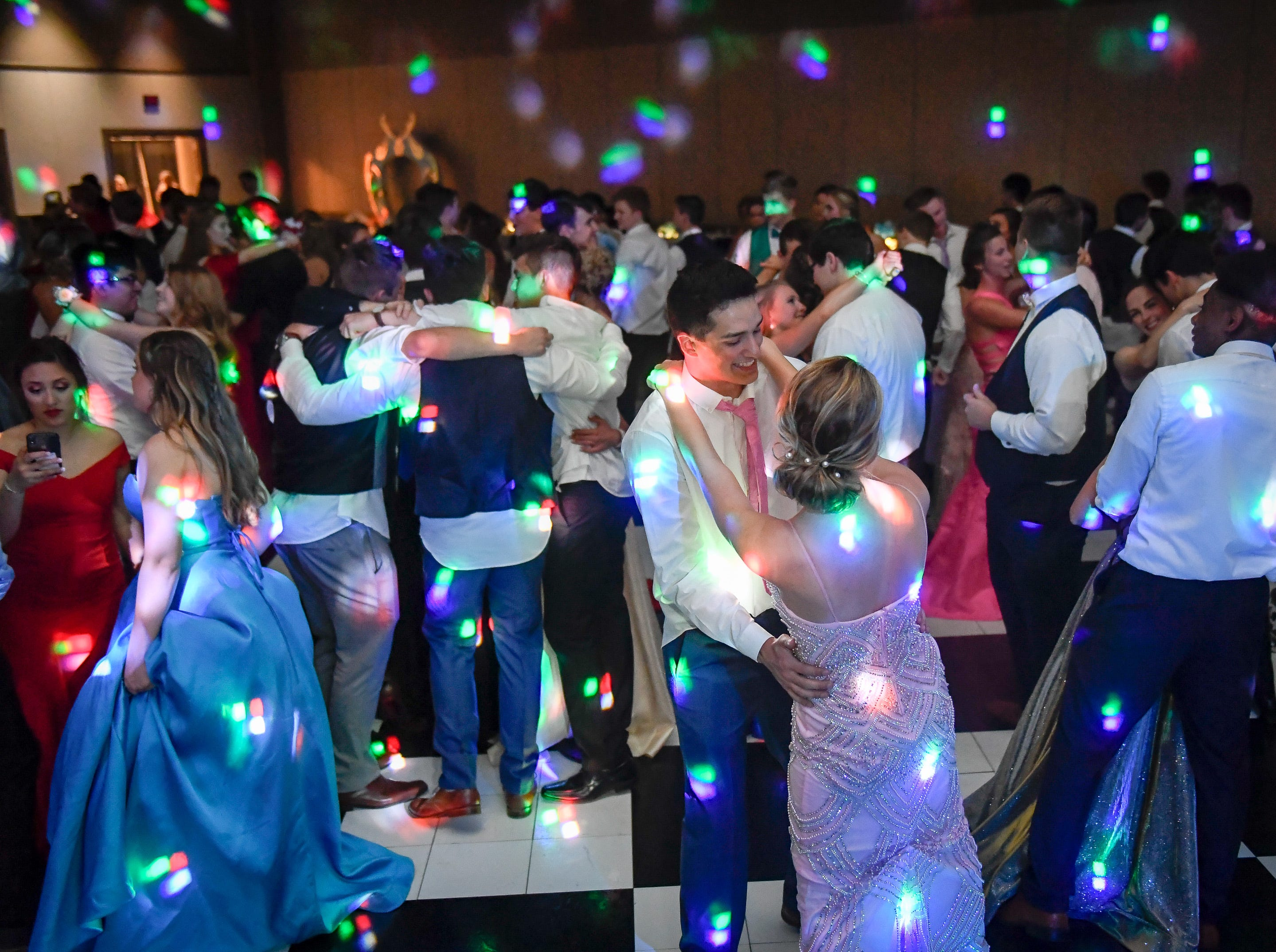 Dancing at the Memorial High School prom, held at the Old National Events Center Plaza Saturday, April 27, 2019.
