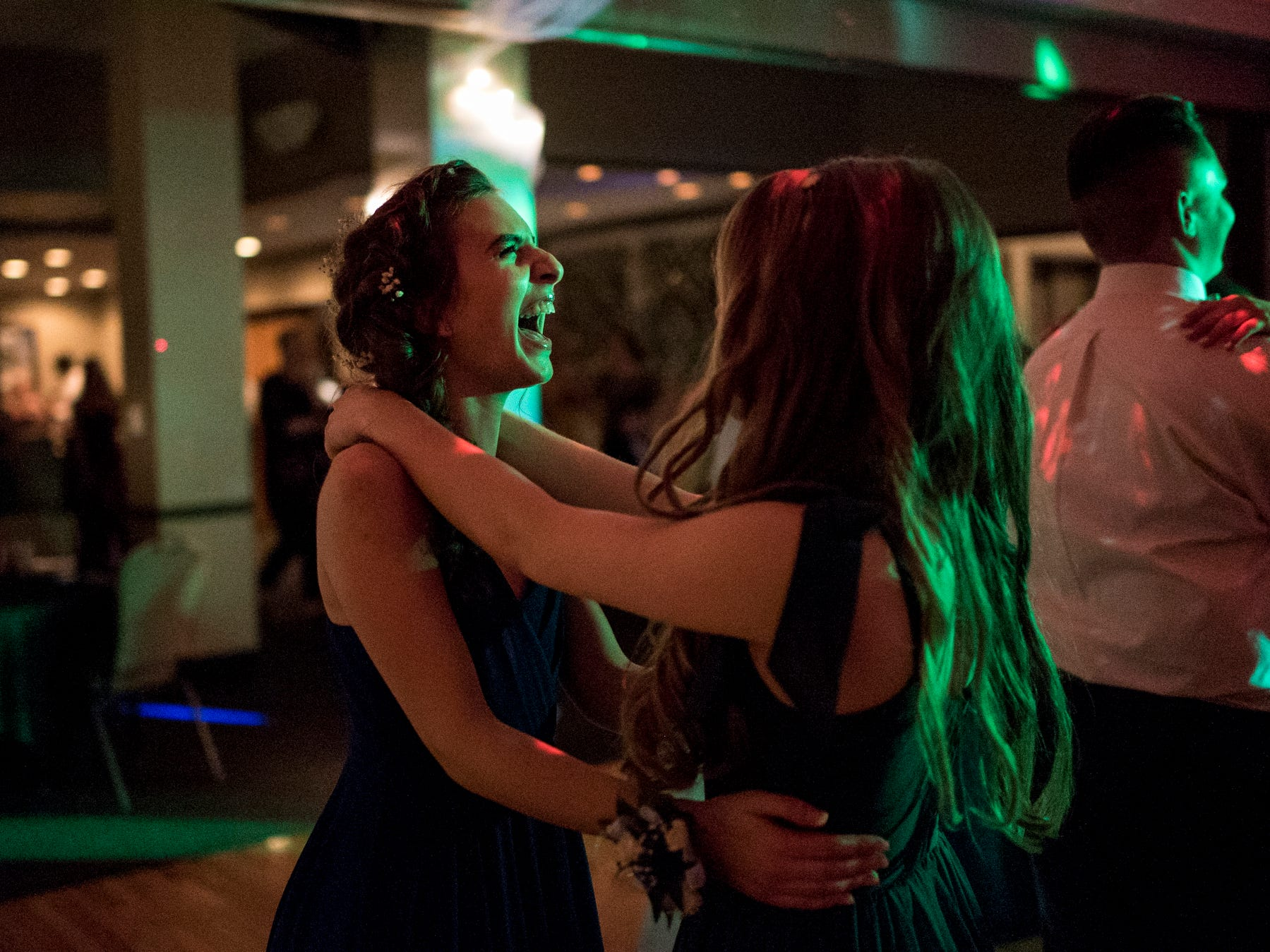 Mater Radovic, left, laughs as she slow dances with Adeleine Halsey, right, during Evansville Day School's prom held at the Hadi Shrine Banquet Hall in downtown Evansville, Ind., Saturday, April 27, 2019.