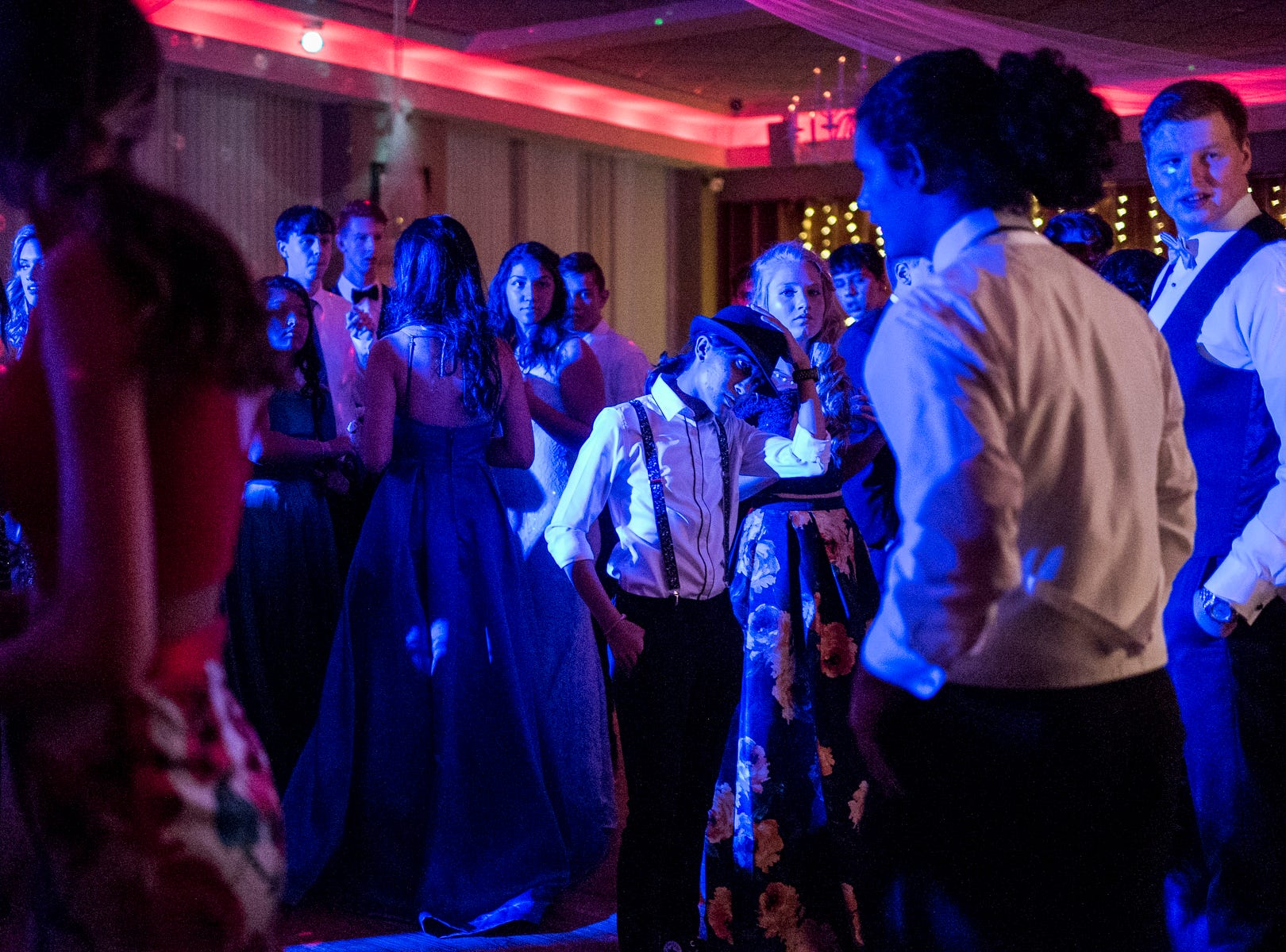 Students listen to music on the dance floor during Evansville Day School's prom held at the Hadi Shrine Banquet Hall in downtown Evansville, Ind., Saturday, April 27, 2019.