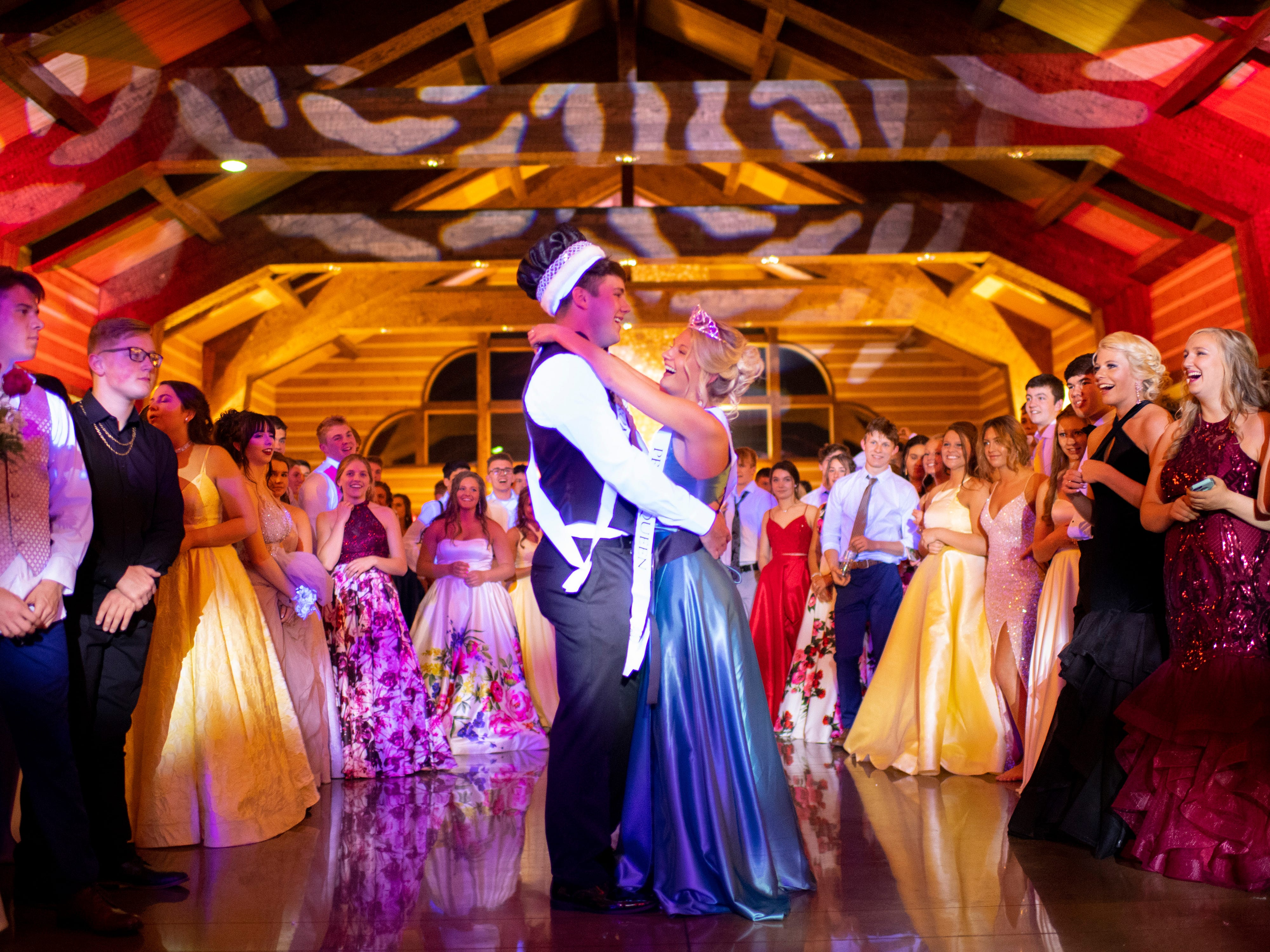 King Ben Ubelhor and Queen Vanessa Van Bibber dance after being crowned at Mater Dei's prom at Burdette Park's Discovery Lodge Saturday night.