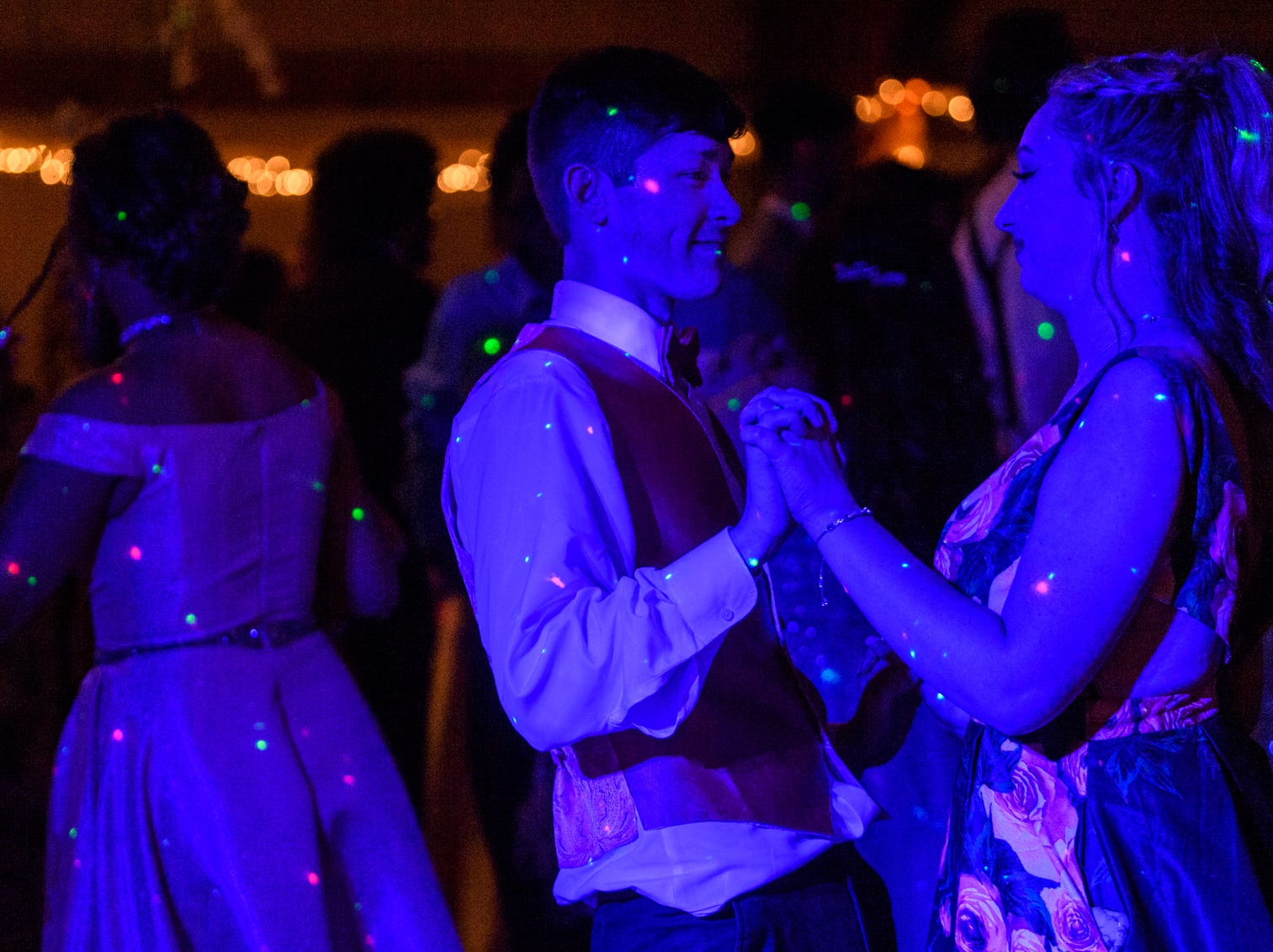"""Jimmy Garris, left, dances with his date Destiny Woods, right, during Central High School's """"Uptown Night"""" themed prom held at the Vanderburgh 4-H Center auditorium in Evansville, Ind., Saturday, April 27, 2019."""